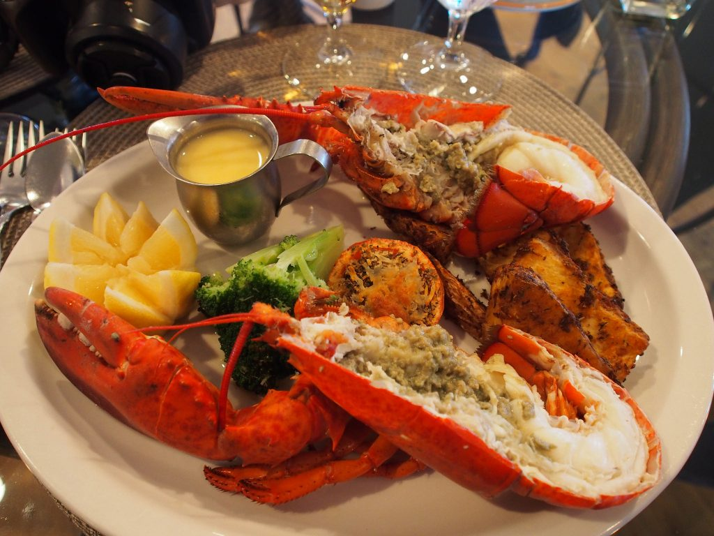 Lobster feast at Island Sunset Resort, Belle Côte, Cape Breton, Nova Scotia | Photo: ModernDayNomads